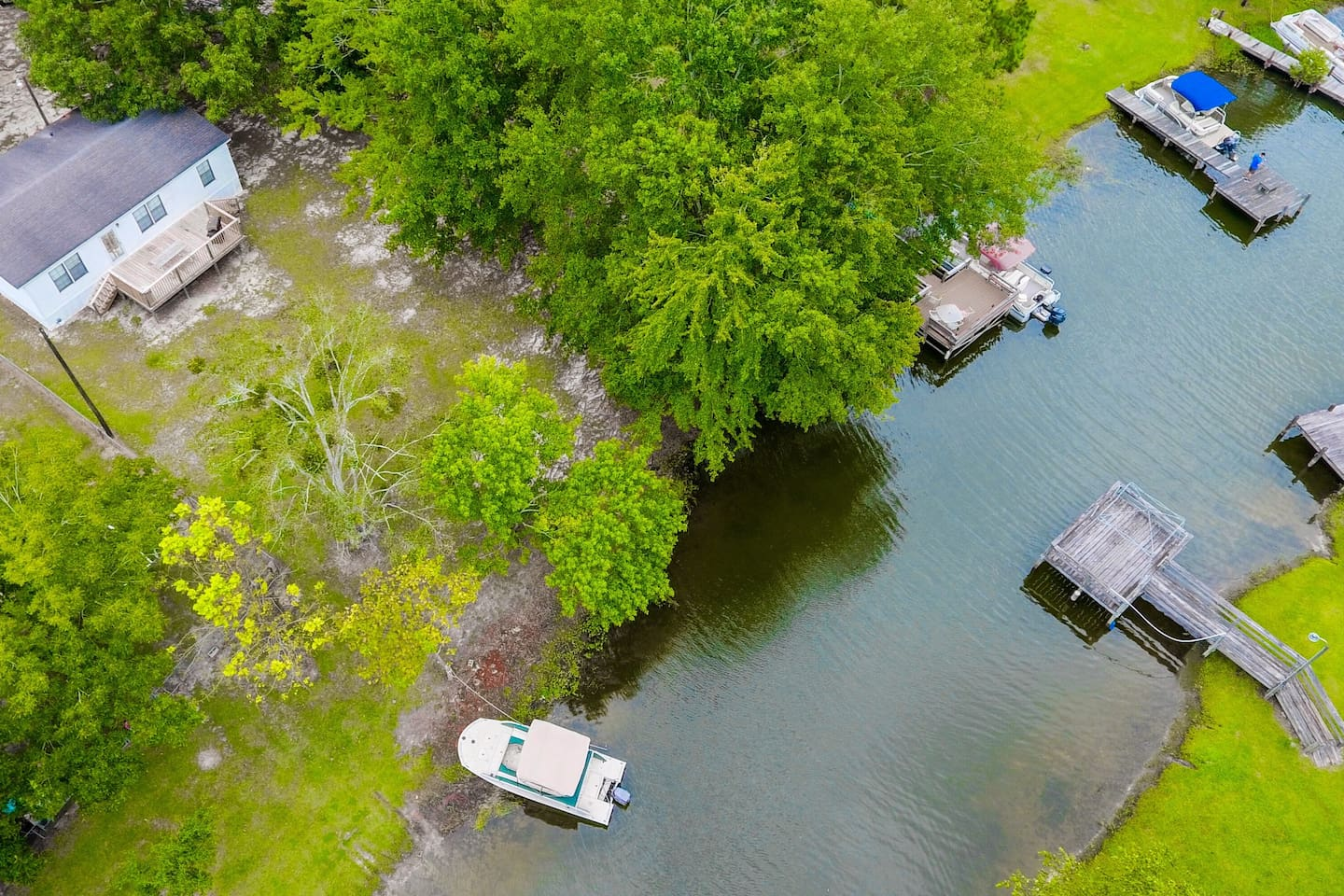 Drone view of home and lake.