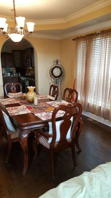 first floor dining table and view into kitchen