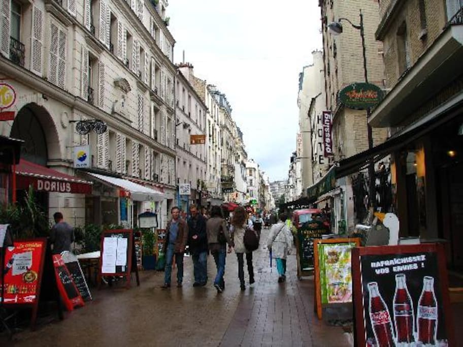 Rue Daguerre, the street right next to the apartment, no cars, just cafes, restaurants, shops and people