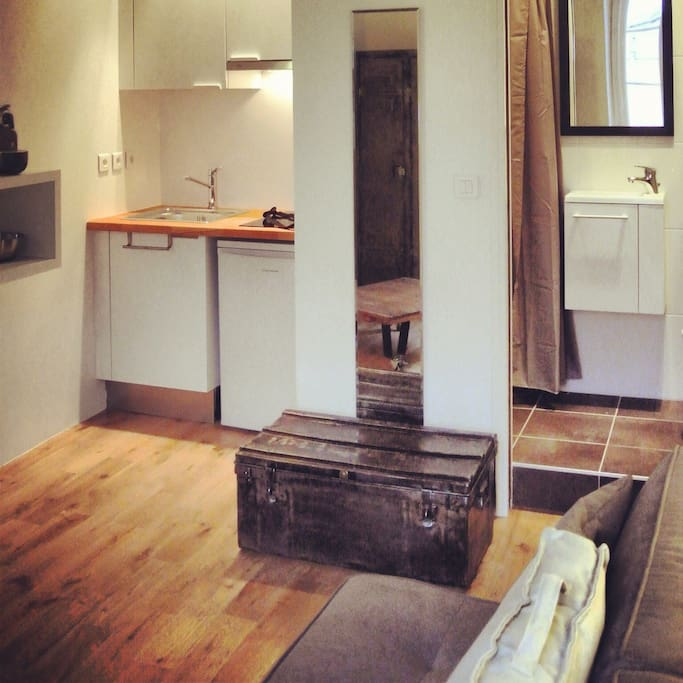 Kitchenette, Mirror, Used & Renovated Military Trunk & Glimpse On The Bathroom