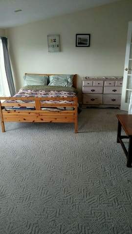 The sun room features a full bed.