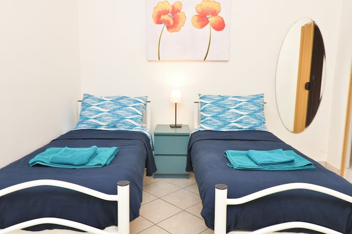 Blue double room with private bath