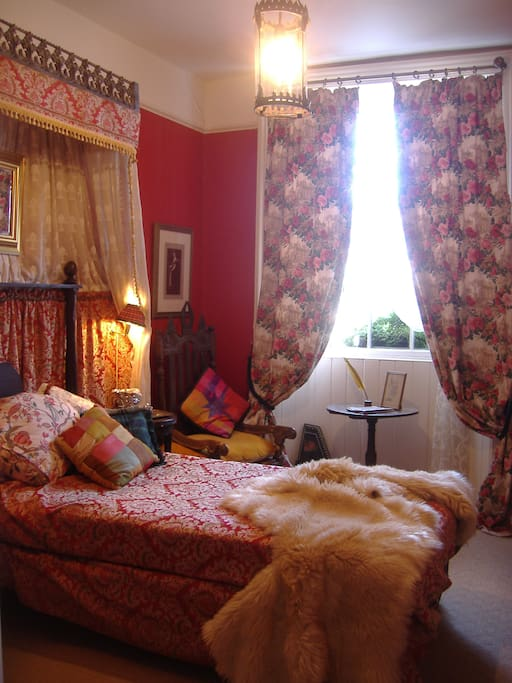 This room is €50 per night. The Red Room has a single canopy bed. With its antique oak furniture, and Moroccan wash-handbasin this cosy room has the look and feel of a 17th century castle interior.