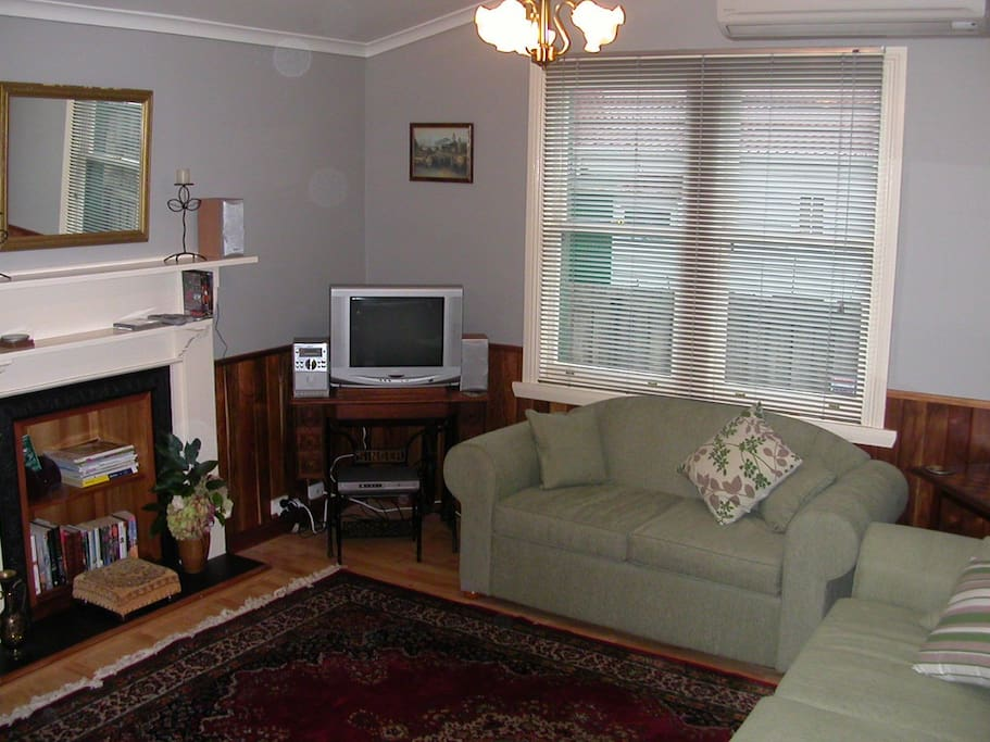 Lounge  room has 2 couches (1 is a DB sofa bed). Reverse cycle air conditioner/heater, door to private back yard