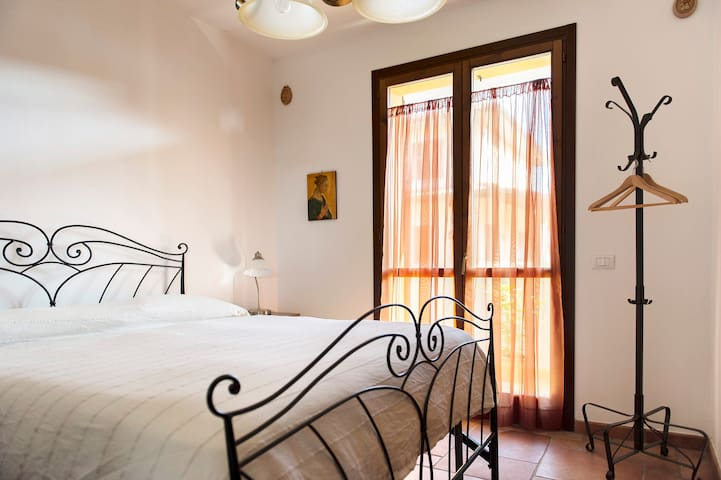 Comfort on a queen bed with romantic balcony and Tuscan decor!