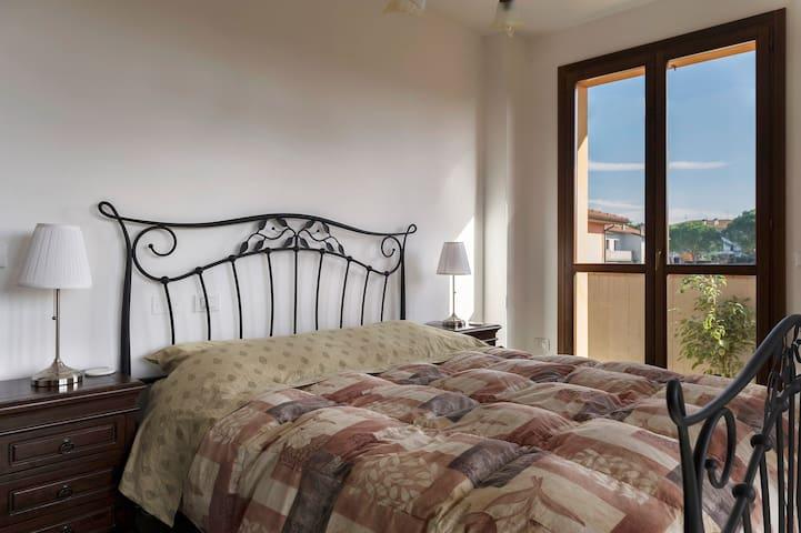 Corner bedroom enjoys 2 French doors and 2 terraces.