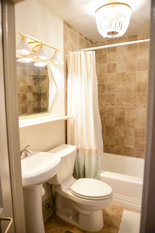 updated private bathroom with tile shower walls