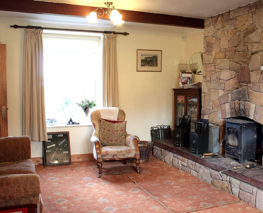 This is the sitting room for guests with the multi fuel stove.