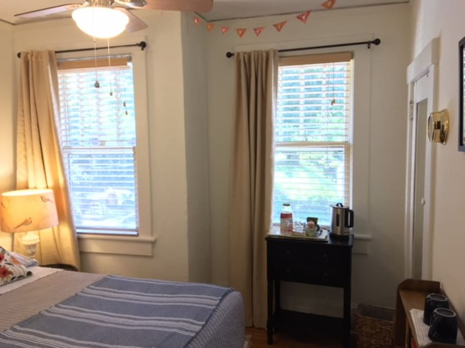 The room is complete with room darkening curtains, electric teapot, and large closet with luggage rack.