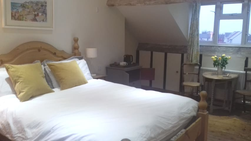 Private, spacious loft room with own en-suite.