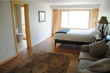 Rooms with a view: spacious master bedroom with ensuite bathroom.