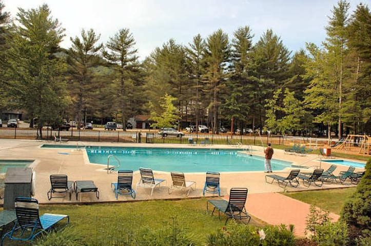 Outdoor Pool across from condo with year-round outdoor jacuzi, barbeque & playground