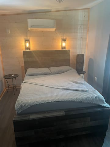 Full size bed with reading lights.