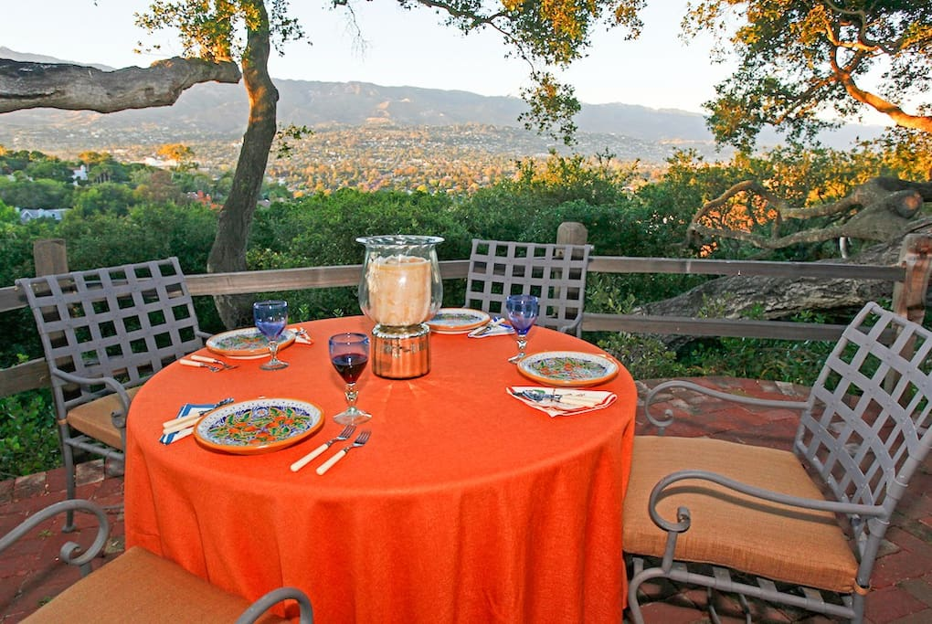 The terrace offers outdoor dining paired with an incredible vantage point of the mountains and city