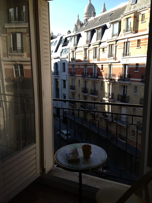 Enjoy the Sacré-Coeur view from the bedroom itself