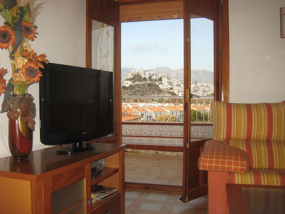 Leave the balcony doors open to enjoy a fresh breeze - and beautiful views - right in the living room.
