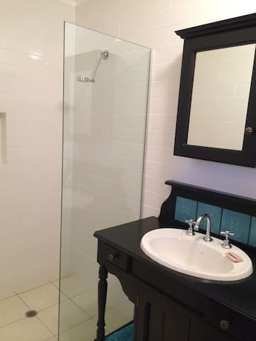 The private bathroom in the poolhouse