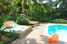 Take the tropical sun on the lounge chairs!