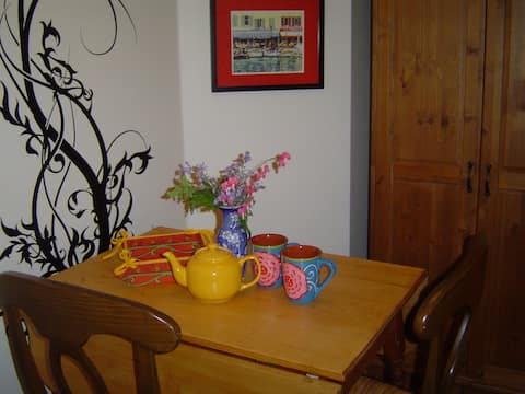 Tea for two! Table seats 4 comfortably in separate kitchen area!