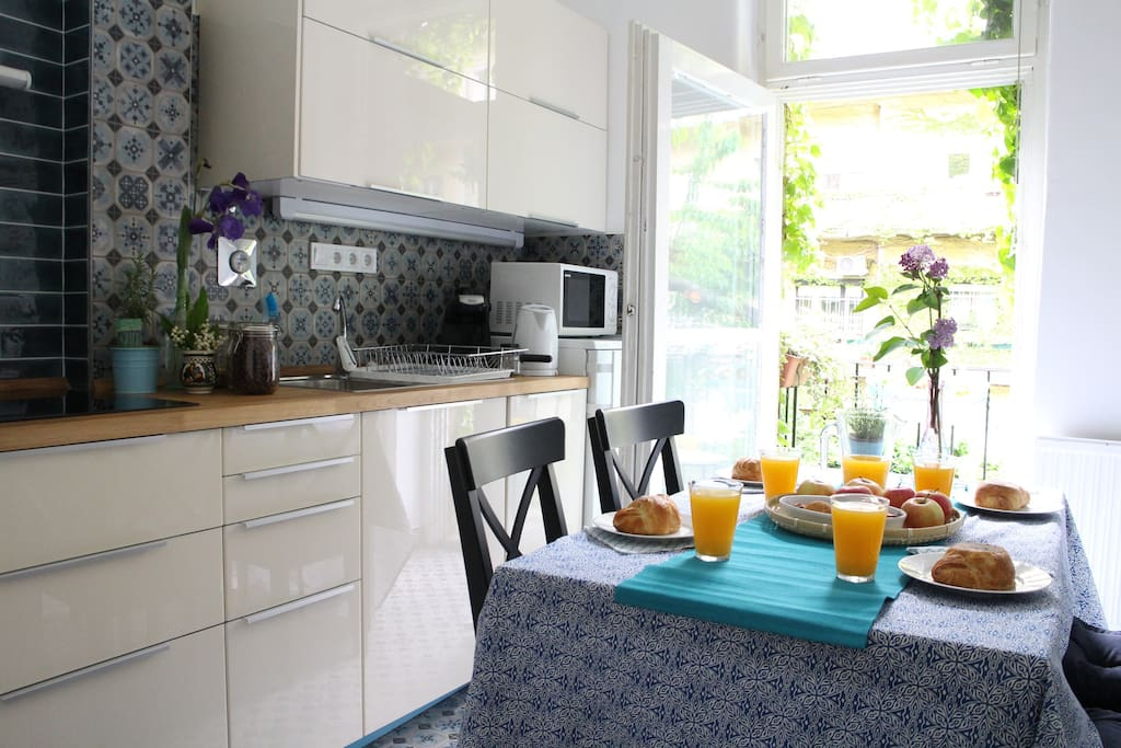 kitchen with a small balcony overlooking to our romantic garden