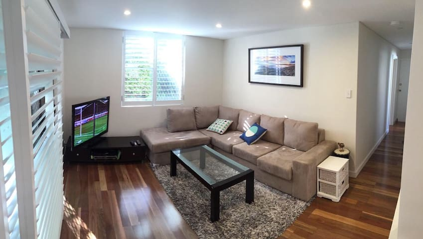 Living room with large comfortable lounge