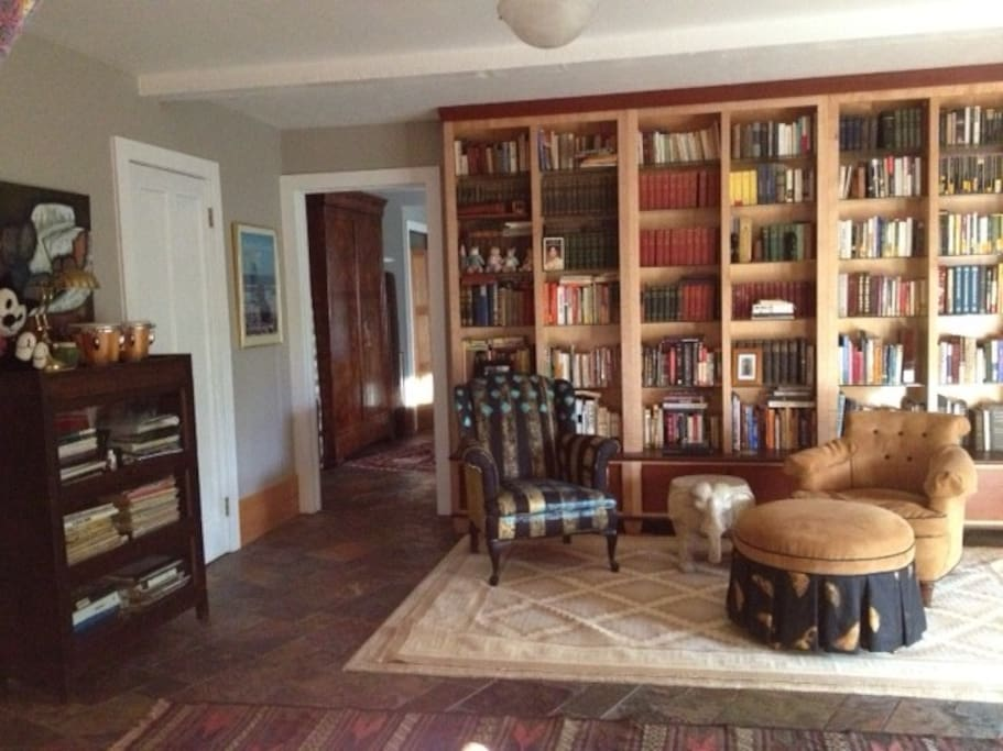 This spacious library entry comes in from the brick patio where often an evening can be spend around the fire pit.
