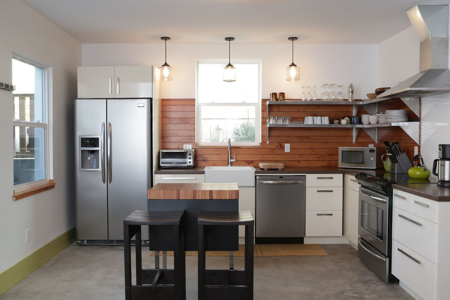 A modern, open, well stocked kitchen is what you walk into off of the patio.