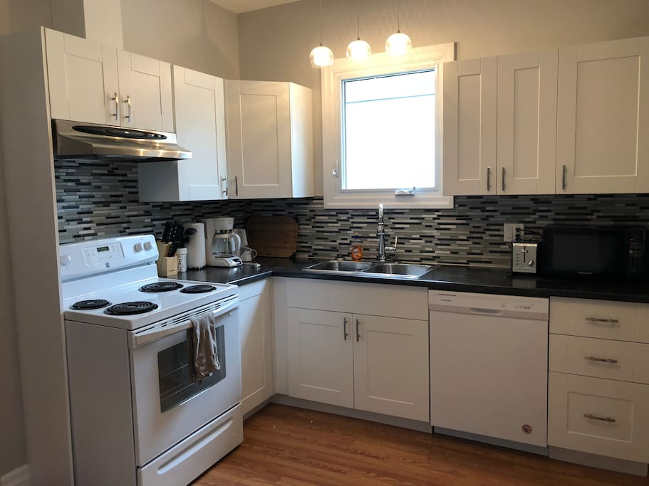 The newly renovated kitchen has all the amenities that you might need including a 12-cup drip coffee maker, dishwasher and oven/stove. Full sized fridge not pictured.