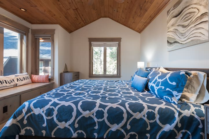 Master bedroom with king bed and sitting area with lake views!