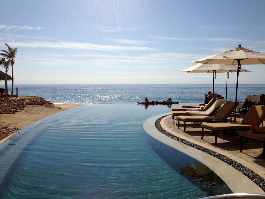 this is an infinity pool with a view of the pacific ocean