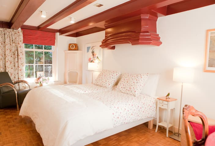 Charming 17th century bedrooom overlooking sunny, private patio. Double or single beds.