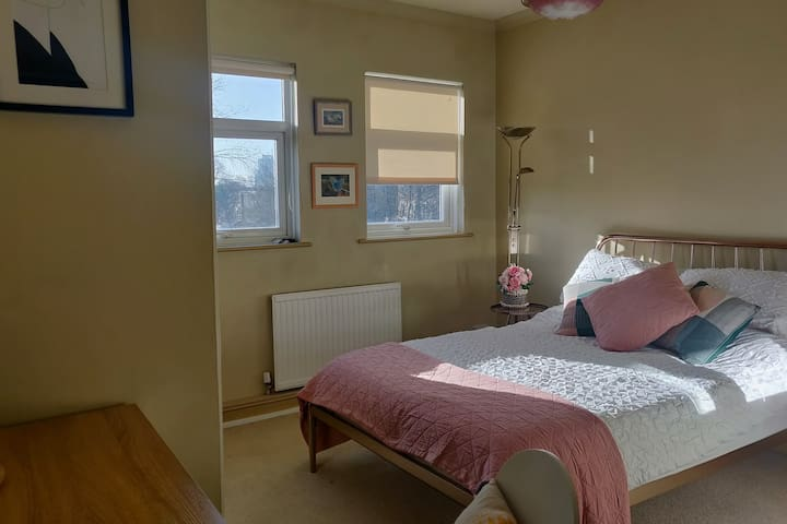 Large, bright bedroom with private ensuite