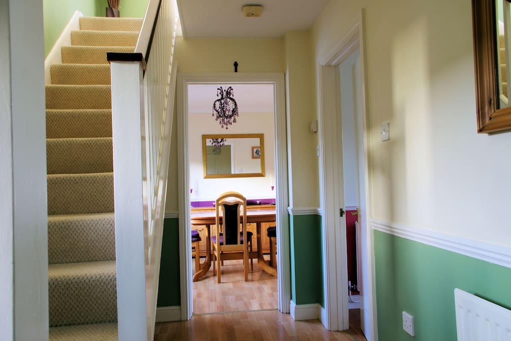 Hallyway leading to dining room                                                     Hallway leading to the stairs and diningroom.