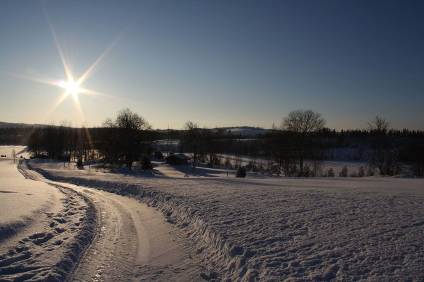 The view over the lake Lambitjärn, no one else lives around the lake, it's like a big private pool - frozen, but still!