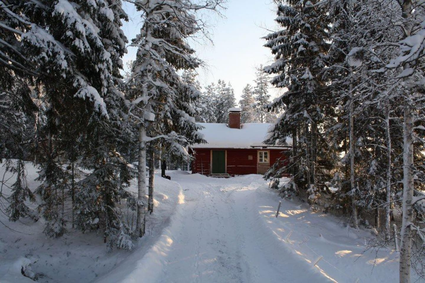 The cabin in the snowy winter.