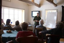 The house is big enough for meetings, here one about Permaculture. Your host, Joel, doing the presentation.