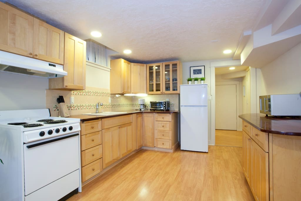 Well equipped kitchen with coffee maker and microwave oven