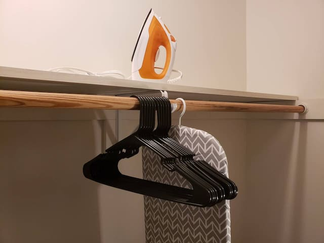 An iron, ironing board and hangers are provided for your convenience. They will be in your closet upon check-in.
