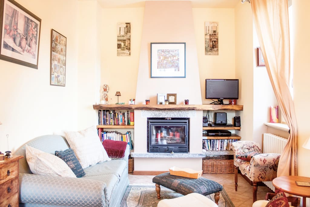 Relax in year-round comfort. Light and airy living room in summer; cosy with central heating and log fire in winter.