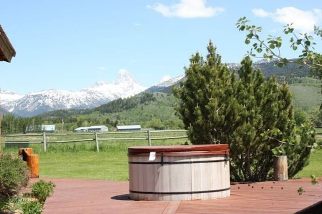 Relax in the shared hot tub while enjoying gorgeous views of the Tetons.