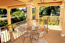 Terrace at front of villa with table and four chairs also has a ceiling fan to keep you cool. Just chill out there and relax, you are on holidays.