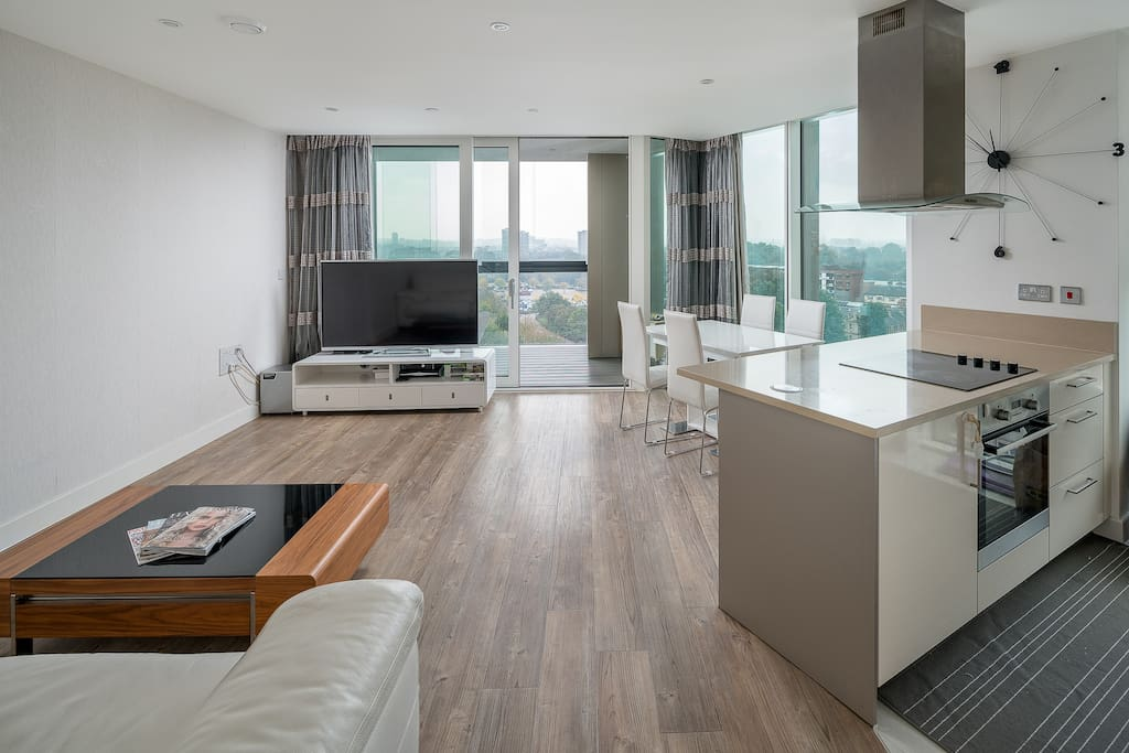 The open-plan living, dining and kitchen area is light and airy.
