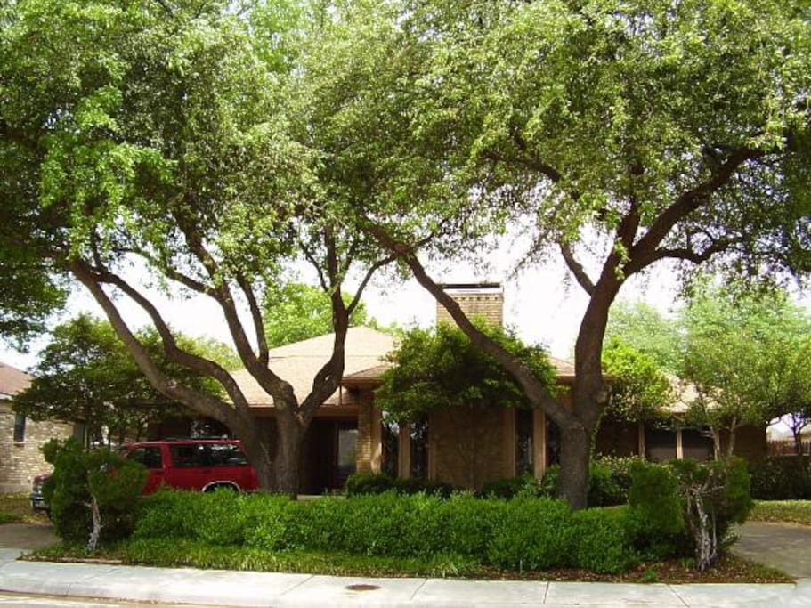 Large Far North Dallas home has many shady trees.