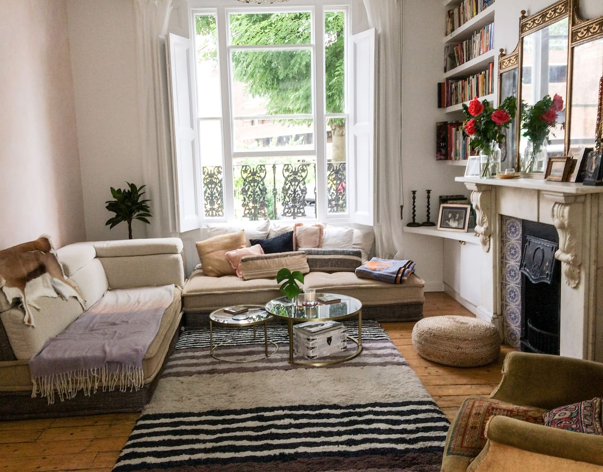 Sunny and spacious living room with antique wooden floorboards