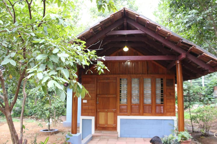 WHISPERING WOODS COORG