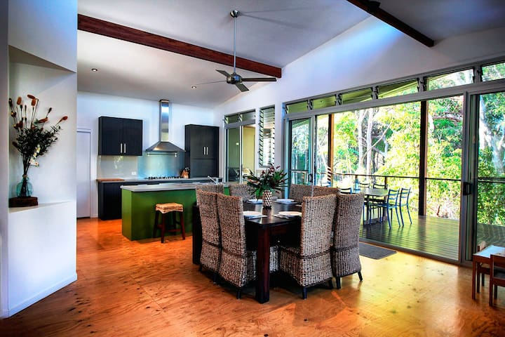 Open plan kitchen / dining leading onto top deck