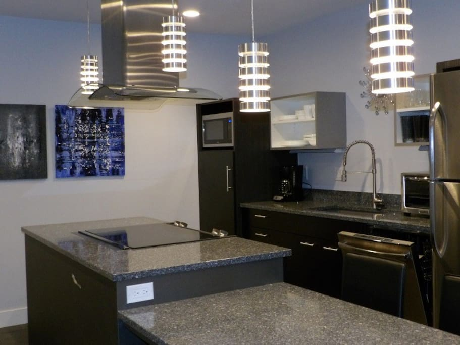 Our stylish kitchen would impress any foodie! The drawers are stocked to the gills with all new everything!