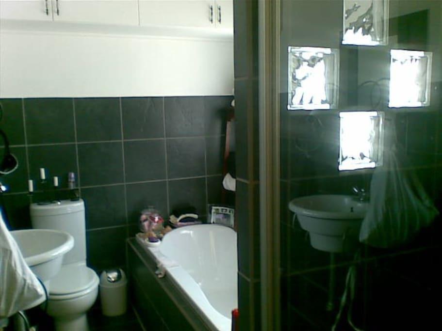 En suite bathroom ith bath and shower