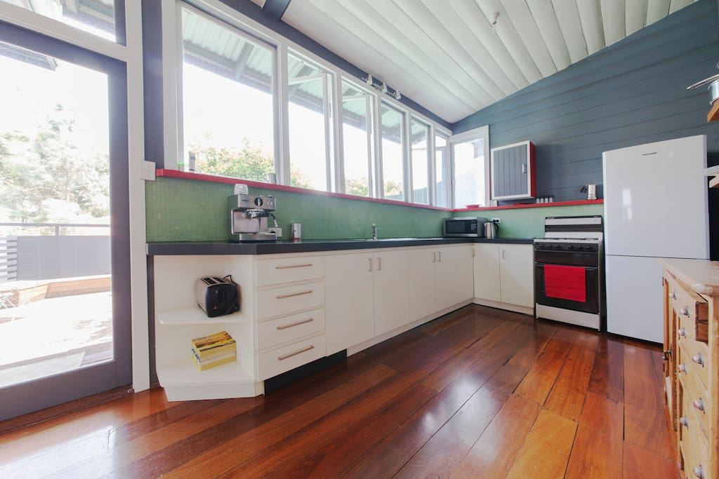 Excellent light into kitchen from backyard - opening double doors to stairs and backyard