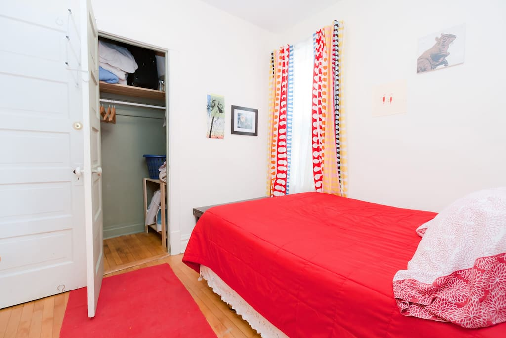 Cozy guest room is 10'x9' with queen sized bed, full-length mirror, closet with plenty of hanging space, alarm clock, small desk, dresser, and bench for your luggage.